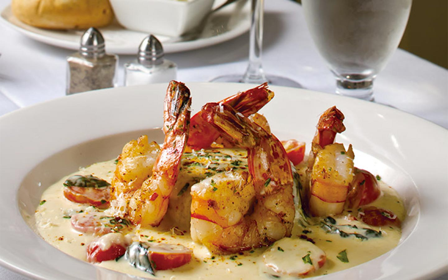 Shrimp in a creamy sauce with basil and tomatoes at our Edenton, NC Restaurant